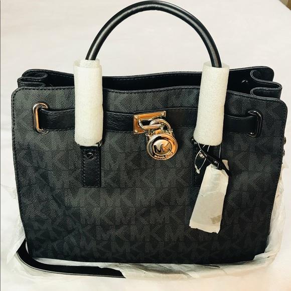 Michael Kors Handbags - BNWT Michael Kors 100% Authentic Purse Black